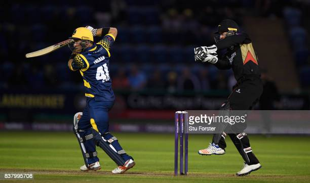 Glamorgan batsman Colin Ingram hits out watched by Luke Ronchi during the NatWest T20 Blast QuarterFinal match between Glamorgan and Leicestershire...