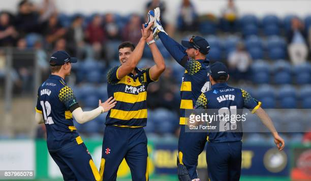 Glamorgan bowler Marchant de Lange is congratulated by team mates after dismissing Leicestershire batsman Cameron Delport during the NatWest T20...