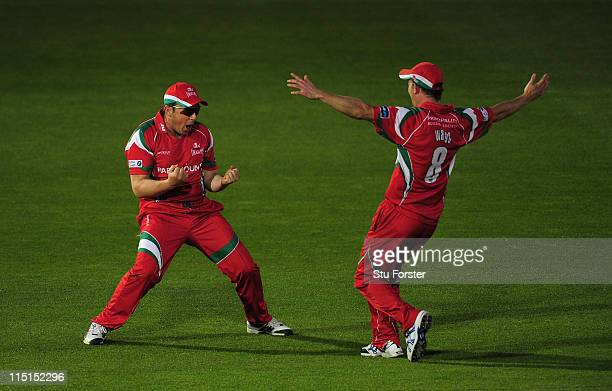 Glamorgan fielder Robert Croft celebrates with Graham Wagg after taking a great catch to dismiss Scott Newman during the Friends Life T20 match...