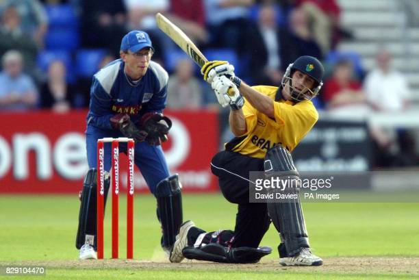 Glamorgan's David Hemp sweeps at a delivery from warwickshire's Bard Hogg during the Twenty 20 Cup Quarter Final match at Sophia Gardens Cardiff