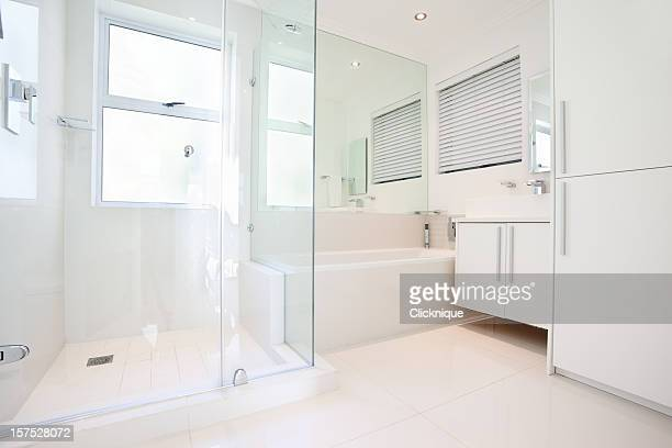 Glamorous, all white, modern bathroom