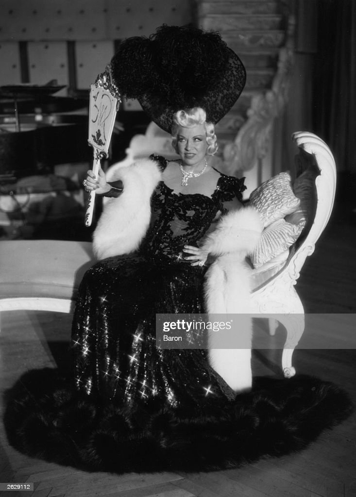 Glamorous American film star and sex symbol Mae West (1892 - 1980).