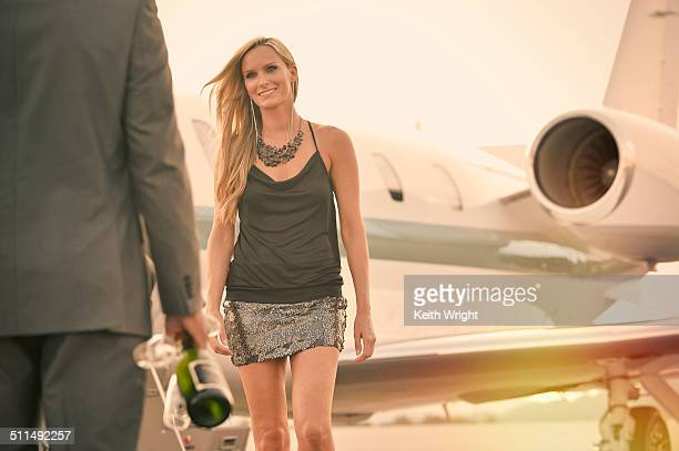 Glamorous couple flying on a private jet.