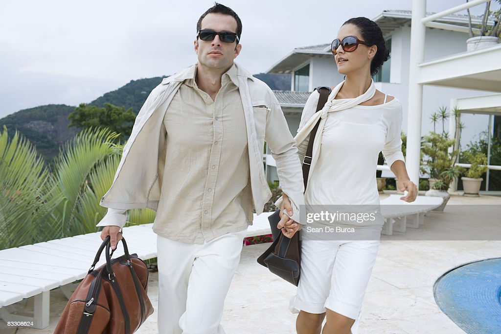Glamorous couple rushing