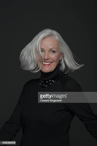 glamorous mature woman. hair flying