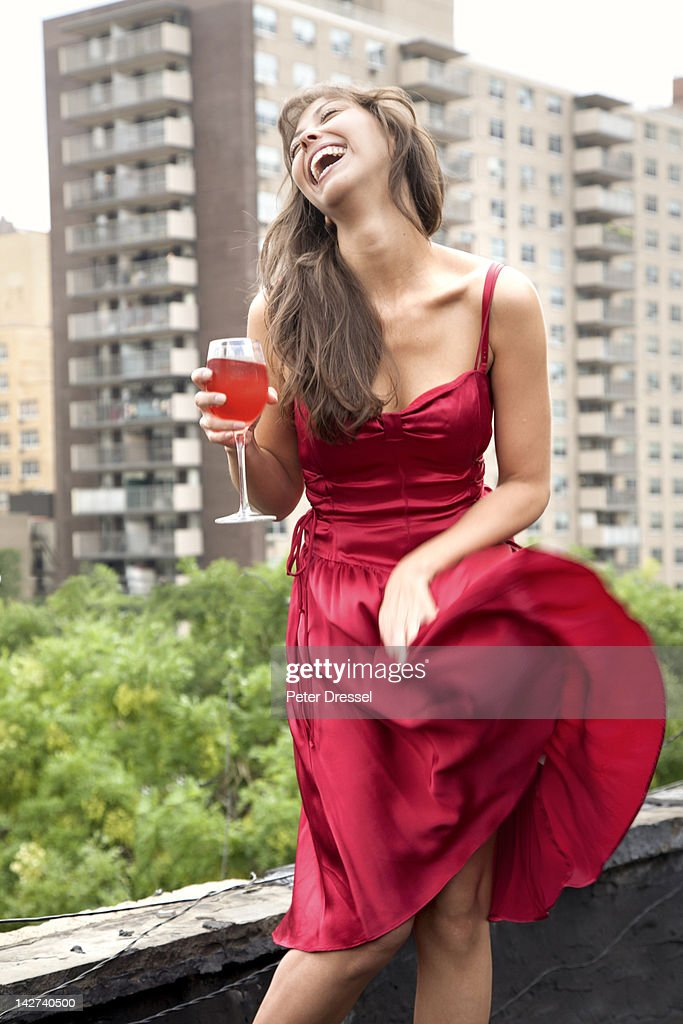Glamorous mixed race woman drinking wine outdoors