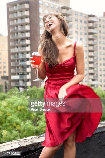 Glamorous mixed race woman drinking wine outdoors : Stock Photo