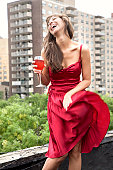 Glamorous mixed race woman drinking wine outdoors