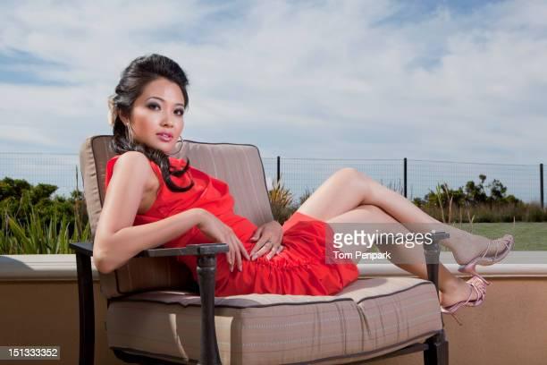 Glamorous mixed race woman relaxing outdoors