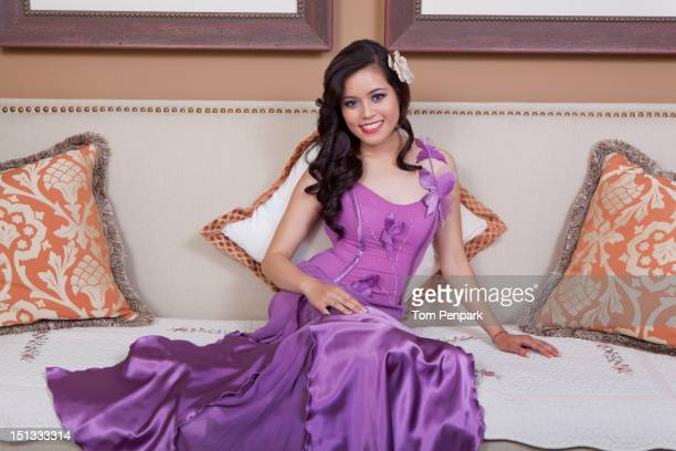 Glamorous mixed race woman sitting in living room