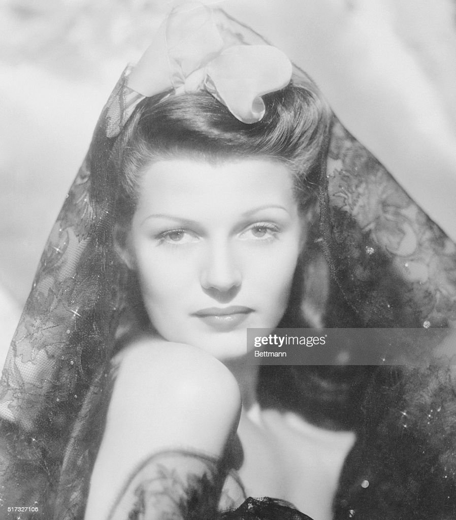 'Glamorous' Rita Hayworth. Hollywood, California: Columbia Studio's ace still man, A.L. 'Whitey' Schafer comes up with this wonderful 'glamor' portrait of actress Rita Hayworth. Is it really all glamour? Look at photo LA 605812. The camera was just moved to a few feet back.