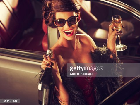 Glamorous Woman Celebrating New Year With Champagne