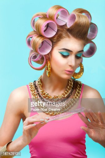 Glamorous woman in a beauty salon filing her nails