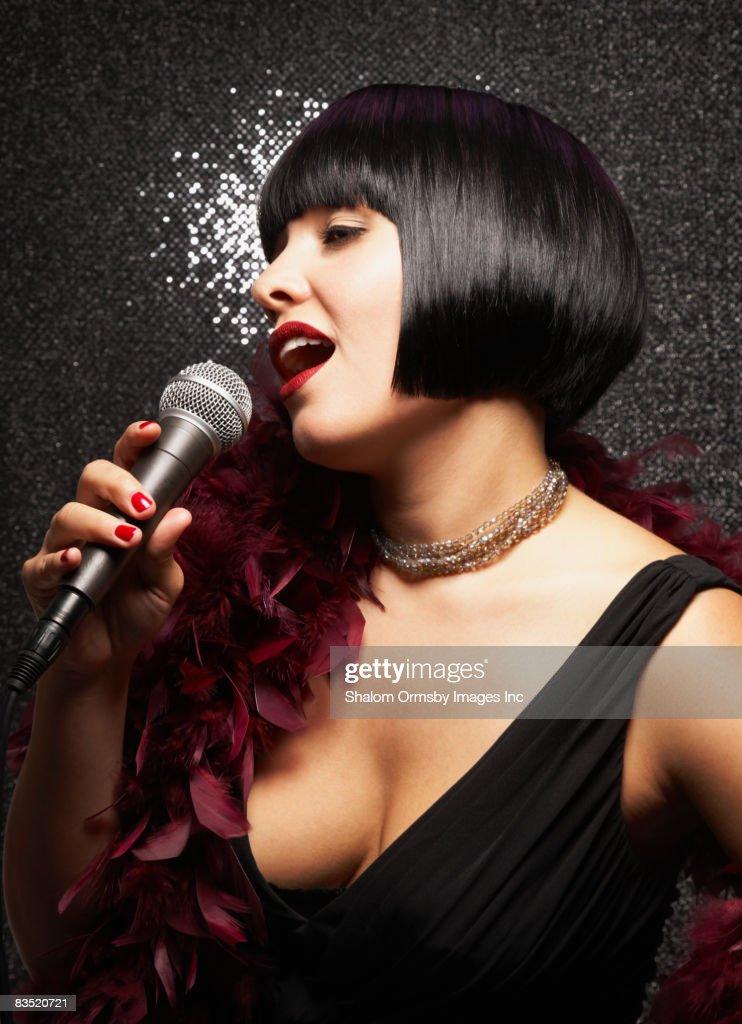 Glamorous woman in feather boa singing