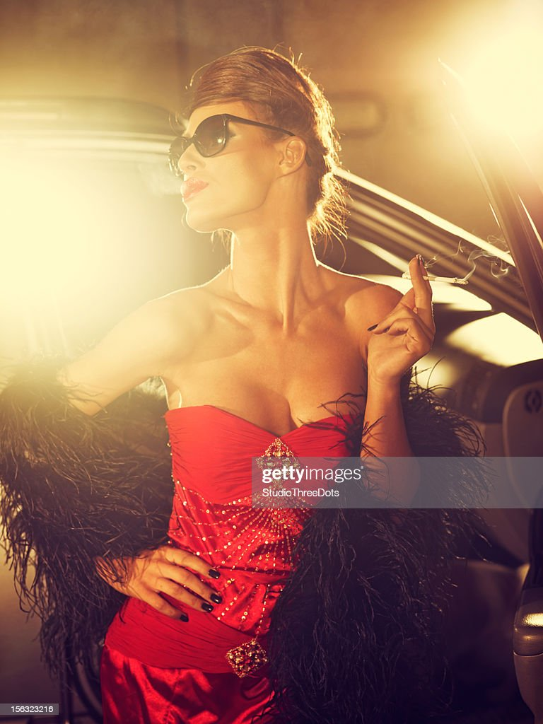 Glamorous Woman In Red Evening Gown Posing For Photographers