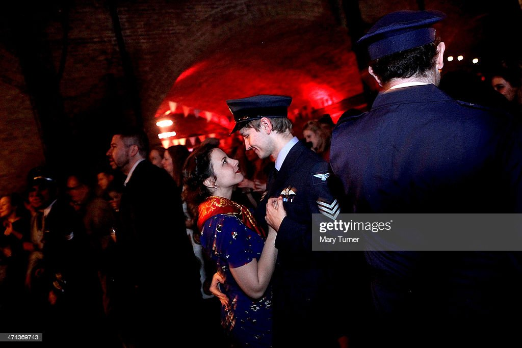 A glamorous young couple in 1940s costume dance together at The Blitz Party on February 22, 2014 in London, England. Deep in an East End bunker hundreds of vintage enthusiasts partied like it was 1940 in a range of wartime costumes, dancing to Swing and Jazz music while drinking themed cocktails at the venue's Spitfire Bar, as they embraced the glamour of and nostalgia for the era.