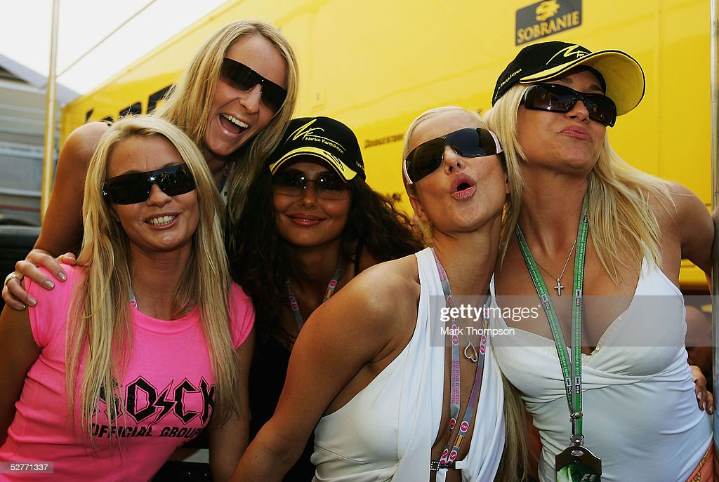 Glamour girls pose outside in the paddock after practice prior to qualifying for the Formula One Spanish Grand Prix at the Circuit de Catalunya on...
