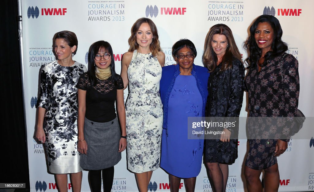 Glamour Magazine Editor in Chief <a gi-track='captionPersonalityLinkClicked' href=/galleries/search?phrase=Cynthia+Leive&family=editorial&specificpeople=2254155 ng-click='$event.stopPropagation()'>Cynthia Leive</a>, honoree Bopha Phorn, actress <a gi-track='captionPersonalityLinkClicked' href=/galleries/search?phrase=Olivia+Wilde&family=editorial&specificpeople=235399 ng-click='$event.stopPropagation()'>Olivia Wilde</a>, Lifetime Achievement Award winner Edna Machirori, journalist <a gi-track='captionPersonalityLinkClicked' href=/galleries/search?phrase=Maria+Shriver&family=editorial&specificpeople=179436 ng-click='$event.stopPropagation()'>Maria Shriver</a> and TV personality Omarosa Manigault attend the IWMF Courage in Journalism Awards 2013 at the Beverly Hills Hotel on October 29, 2013 in Beverly Hills, California.
