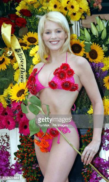 Glamour model Jo Hicks wearing a bikini made out of fresh flowers during a photocall to launch Interflora Live at Olympia Interflora Live will form...