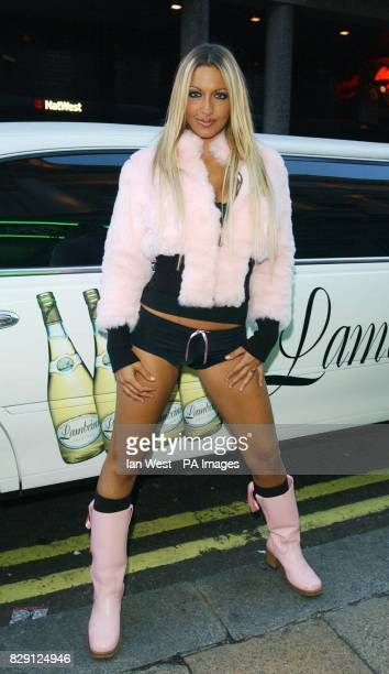 Glamour model Jodie Marsh arrives for the 'Search For The Lambrini Girl 2004' party which she is judging at On Anon in Piccadilly Circus central...