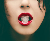 Glamour Portrait - Red Lip holding heart shape ice - Closeup