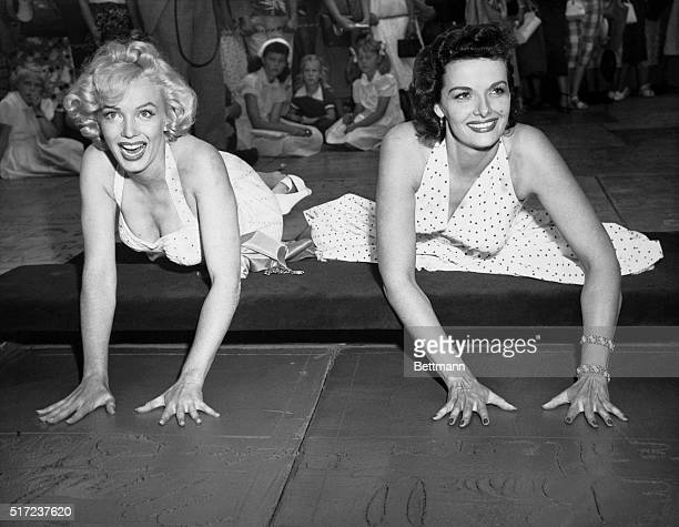 Glamour queens Marilyn Monroe and Jane Russell needless to say made Hollywood's hall of fame at Grauman's Chinese Theatre while extra police kept...