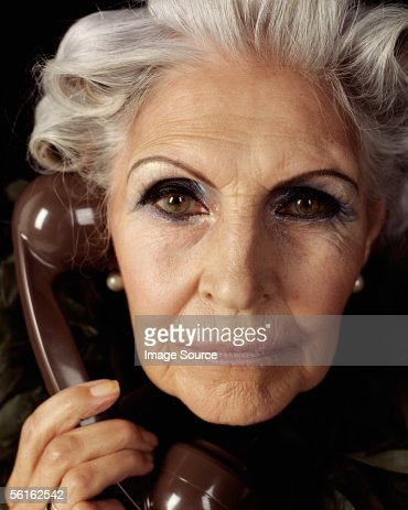 glamourous senior woman on telephone photo getty images. Black Bedroom Furniture Sets. Home Design Ideas