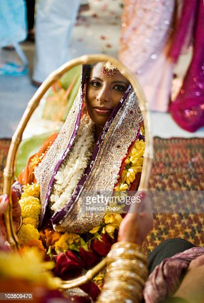 Glancing at the bride in the mirror