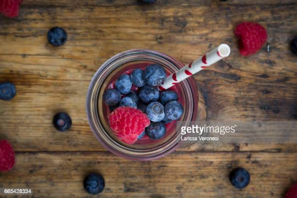Glas of berry smoothie with blueberries and raspberries