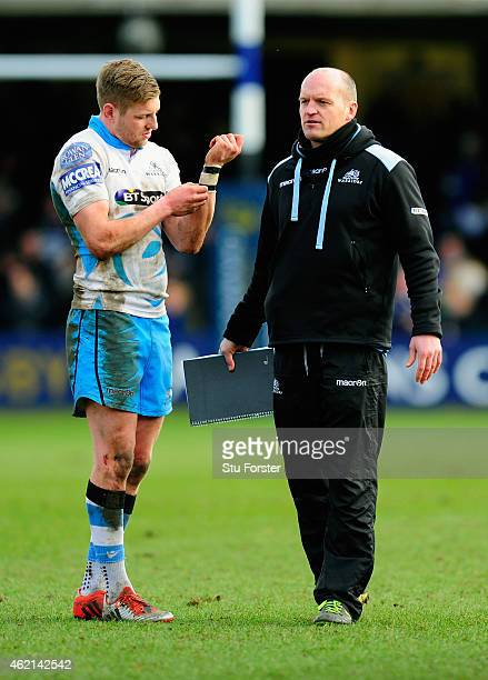 Glasgow flyhalf Finn Russell chats with coach Gregor Townsend after the European Rugby Champions Cup match between Bath Rugby and Glasgow Warriors at...