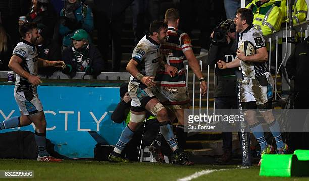 Glasgow player Mark Bennett celebrates the second try during the European Rugby Champions Cup match between Leicester Tigers and Glasgow Warriors at...