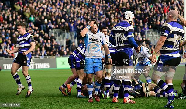 Glasgow player Peter Horne reacts as Bath player George Ford celebrates after the European Rugby Champions Cup match between Bath Rugby and Glasgow...