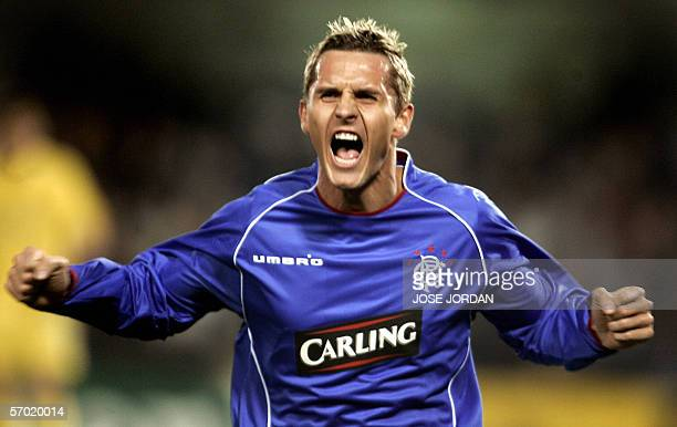 Glasgow Rangers' Danish Peter Lovenkrands celebrates his goal during their Champions league second leg football match at Madrigal stadium of...