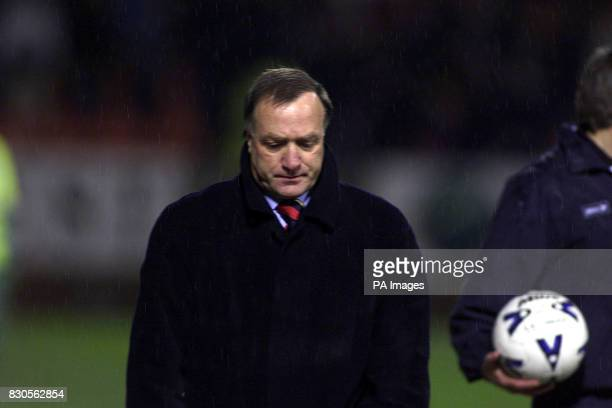 Glasgow Rangers' dejected manager Dick Advocaat walks off the pitch after their Scottish Cup fifth round football match defeat by Dundee United at...