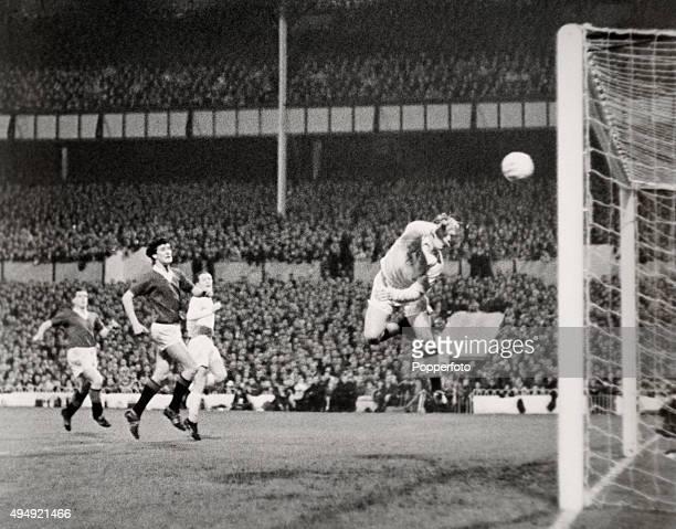 Glasgow Rangers goalkeeper Billie Ritchie makes a dive but fails to stop Tottenham Hotspur centreforward Les Allen's header watched by Rangers'...