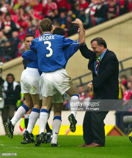 Glasgow Rangers manager Dick Advocaat grabs the arm of Tony Vidmar as he celebrates his goal against Aberdeen during their Tennents Scottish Cup...