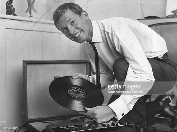Glasgow Rangers player Ferguson putting on a record by Ray Conniff and his orchestra Scottish footballer Ferguson played for St Johnstone Dunfermline...