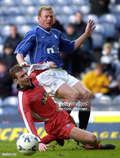 Glasgow Rangers player Jorg Albertz sets up a shot for team mate Kenny Miller to score the second goal past Brechin's Greig Smith but injures himself...