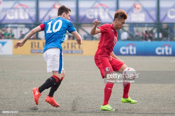 Glasgow Rangers' Ross Lyon competes with HKFA Red Dragons'' Cheng Siu Kwan during the HKFC Citi Soccer Sevens 2017 Group A Main Tournament match...