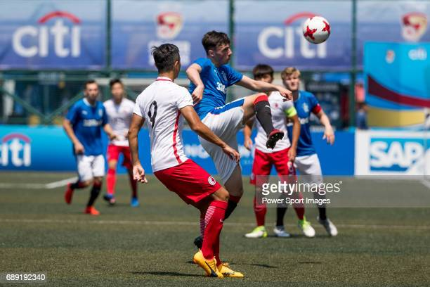 Glasgow Rangers' Ross Lyon competes with HKFA U23 Lai Hau Hei for a ball during their Main Tournament Cup QuarterFinal match part of the HKFC Citi...