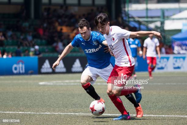 Glasgow Rangers' Ross Lyon competes with HKFA U23 Lam Jordan Lok Kan for a ball during their Main Tournament Cup QuarterFinal match part of the HKFC...