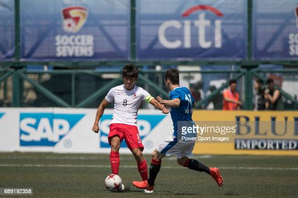 Glasgow Rangers' Ross Lyon competes with HKFA U23's Tan Chun Lok for a ball during their Main Tournament Cup QuarterFinal match part of the HKFC Citi...