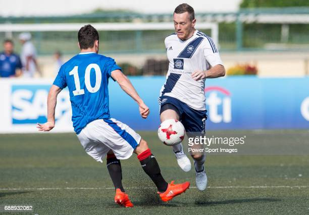 Glasgow Rangers' Ross Lyon competes with HKFC's Steve McGurgan for a ball during the HKFC Citi Soccer Sevens 2017 Group A Main Tournament match...