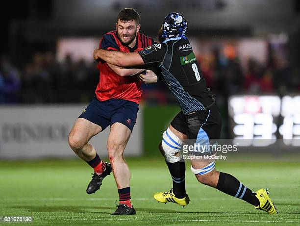 Glasgow United Kingdom 14 January 2017 Jaco Taute of Munster is tackled by Josh Strauss of Glasgow Warriors during the European Rugby Champions Cup...