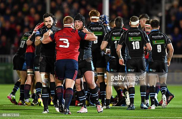 Glasgow United Kingdom 14 January 2017 John Ryan of Munster with Alex Dunbar left and Zander Fagerson of Glasgow Warriors during the European Rugby...
