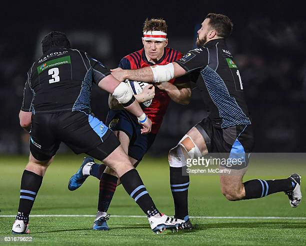 Glasgow United Kingdom 14 January 2017 Rory Scannell of Munster is tackled by Zander Fagerson left and Alex Dunbar of Glasgow Warriors during the...