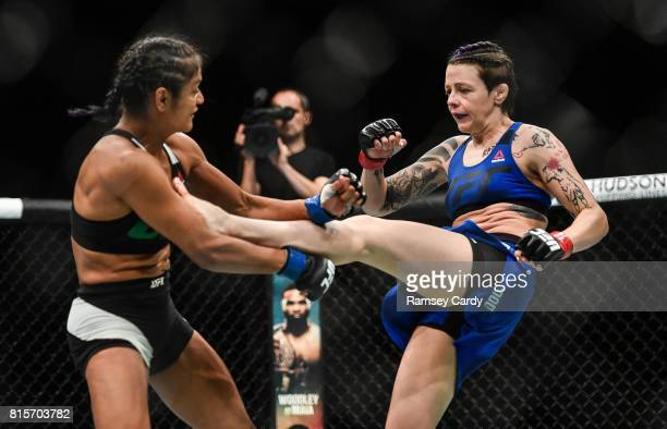 Glasgow United Kingdom 16 July 2017 Joanne Calderwood right in action against Cynthia Calvillo during their strawweight bout at UFC Fight Night...