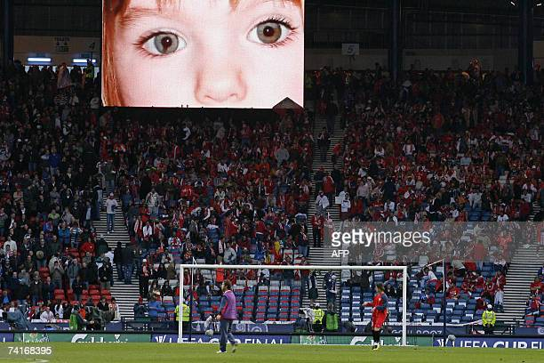 An image of missing British child Madeleine McCann is displayed in Hampden Park Stadium in Glasgow in Scotland 16 May 2007 in the UEFA Cup Final...