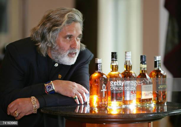 Chairman of the Indian conglomerate UB Group Dr Vijay Mallya examines bottles of whisky made by Scotch whisky maker Whyte and Mackay after addressing...