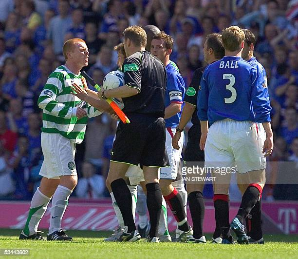 Neil Lennon argues with match officials after being red carded by referee Stuart Dougal 20 August 2005 during the Rangers v Celtic game in the...
